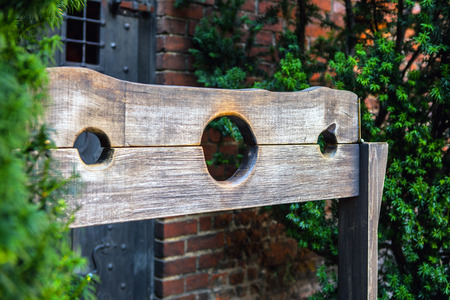 mockery: Wooden medieval torture device, ancient pillory.