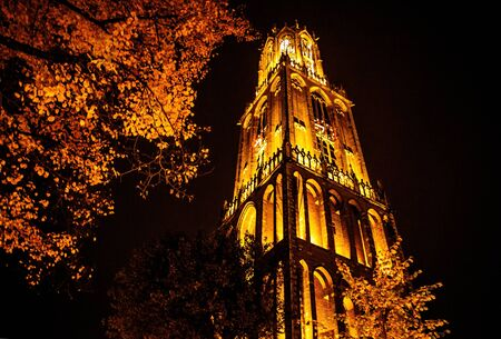 dom: Ancient European church with night-time lighting. Utrecht - Holland.