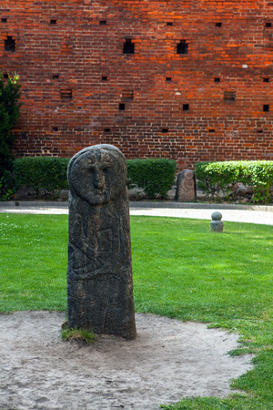 copernicus: Ancient stone idol in yard of Castle of Nicolaus Copernicus in Olsztyn - Poland.