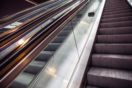 angled view: Wide angled view to perspective escalators stairway.