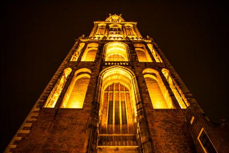 utrecht: Ancient European church with night-time lighting. Utrecht - Holland.