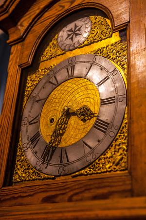 wooden clock: Old vintage wooden clock. Stock Photo