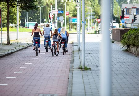 goes: AMSTERDAM, NETHERLANDS - AUGUST 27, 2015: Group of cyclists goes around city. Amsterdam - Netherland. Editorial