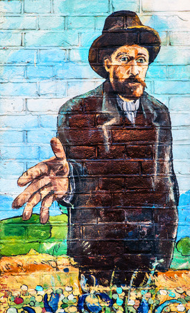 van gogh: NETHERLANDS, AMSTERDAM - OCTOBER 25, 2015: Van Gogh drawing on street wall.
