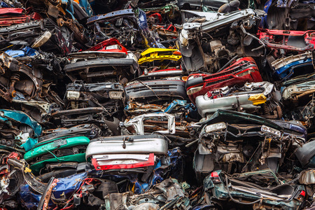 salvage yards: Piled up compressed cars as industrial background.