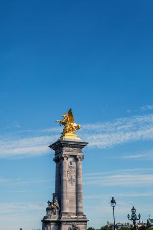 PARIS - FRANCE - AUGUST 30: Sculpture on Alexandre III bridge in Paris on August 30, 2015 in Paris.