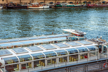 city park boat house: PARIS, FRANCE - AUGUST 28, 2015: Modern transport boat on Siena in summertime. Paris - France.