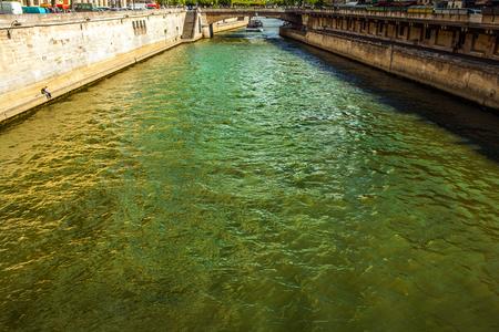 forefront: PARIS, FRANCE - AUGUST 28, 2015: Modern transport boat on Siena in summertime. Paris - France.