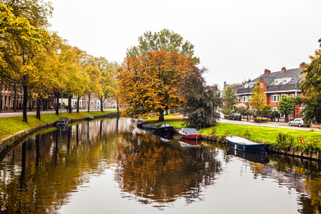 city park boat house: Boat on channel in Haarlem - Holland.