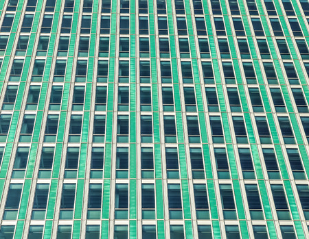 lose up: Green windows of working offices. ?lose up window as background. Stock Photo