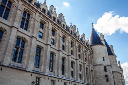 ile de la cite: PARIS, FRANCE - AUGUST 30, 2015: The Conciergerie, located on Ile de la Cite along the river Seine in a medieval Gothic palace, is a former prison which is now a popular tourist attraction in Paris. Editorial