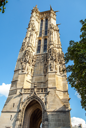 flamboyant: PARIS, FRANCE - AUGUST 30, 2015: Saint-Jacques Tower located on Rivoli street. This 52m Flamboyant Gothic tower is all that remains of former 16 century Church of Saint-Jacques-de-la-Boucherie. Paris.