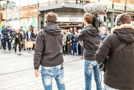almere: ALMERE, NETHERLANDS - OCTOBER 18: Video filming for Dutch show on a city square in Almere. Netherlands.