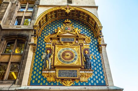 gilded: PARIS, FRANCE - AUGUST 30, 2015: Old gilded city watch on a wall. Paris.