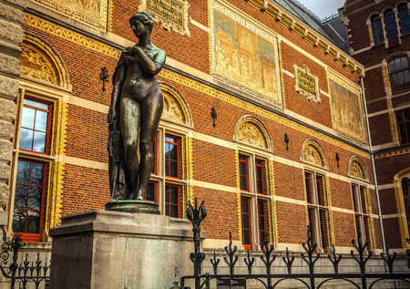 the arts is ancient: AMSTERDAM, NETHERLANDS - JANUARY 1, 2016: Ancient bronze statue in park of The Rijksmuseum (Netherlands national museum dedicated to arts and history in Amsterdam).  Amsterdam - Netherland. Editorial