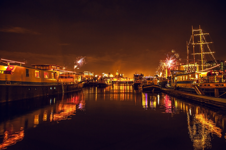 january 1: AMSTERDAM, NETHERLANDS - JANUARY 1, 2016: Festive salute of fireworks on New Years night. On January 1, 2016 in Amsterdam - Netherland.