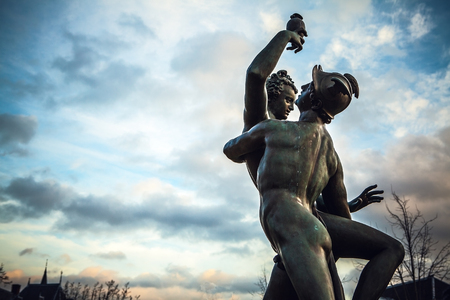 amsterdam: AMSTERDAM, NETHERLANDS - JANUARY 1, 2016: Ancient bronze statue in park of The Rijksmuseum (Netherlands national museum dedicated to arts and history in Amsterdam).  Amsterdam - Netherland. Editorial