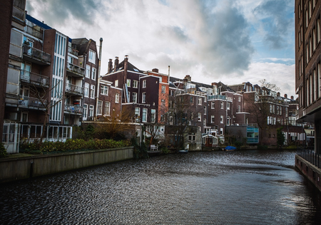 brige: General landscape views from city brige in channels & residential buildings of Amsterdam. Editorial