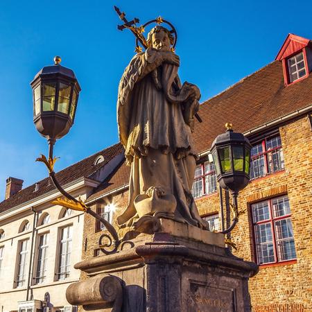 bruges: Bruges - St. John Nepomuk; statue on bridge. Editorial