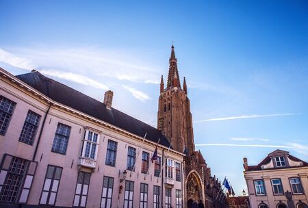 evening church: Medieval Church of Our Lady in Bruges in sunny evening, Belgium.