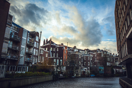 brige: General landscape views from city brige in channels & residential buildings of Amsterdam. Stock Photo