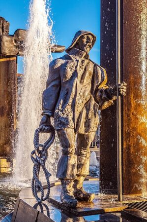 bruges: Fountain in square tZand in Bruges, Belgium. Stock Photo