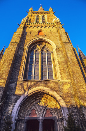 our lady: Medieval Church of Our Lady in Bruges in sunny evening, Belgium.