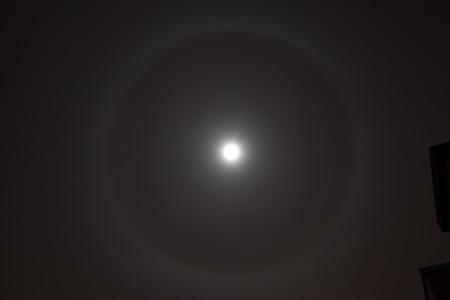 nightime: Closeup of full moon with rare light aura. Stock Photo