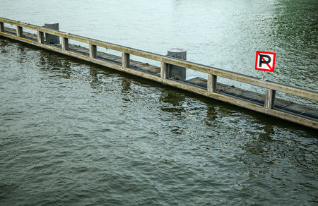 Parking ban sign on water.