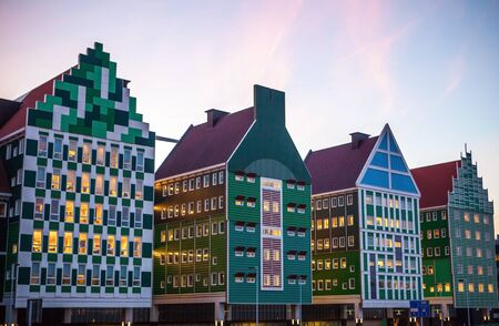 ZAANDAM, NETHERLANDS - MARCH 18, 2016: Inntel hotel at twilight time. Opened in 2009, design attracts guests by incorporating traditional architecture of Zaan region on 18 March in Zaandam, Holland. Editorial