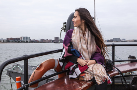 floats: Attractive young woman with long beautiful hairs floats by ship.