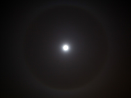 aura: Closeup of full moon with rare light aura. Stock Photo