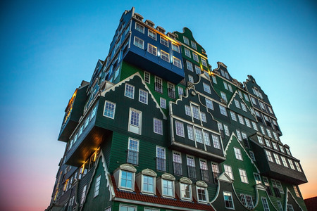 zaandam: ZAANDAM, NETHERLANDS - MARCH 18, 2016: Inntel hotel at twilight time. Opened in 2009, design attracts guests by incorporating traditional architecture of Zaan region on 18 March in Zaandam, Holland. Editorial