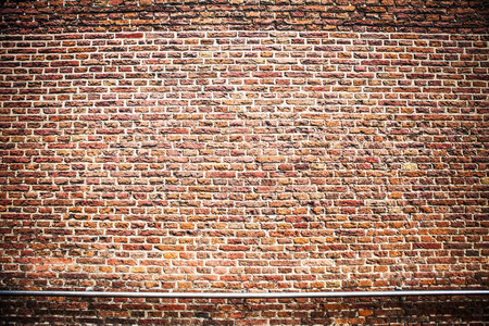 overbuilding: Antique brick stone wall texture. Photo Background. Stock Photo