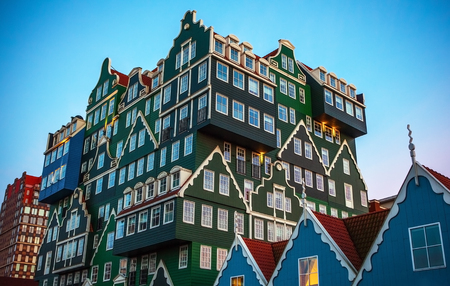 zaan: ZAANDAM, NETHERLANDS - MARCH 18, 2016: Inntel hotel at twilight time. Opened in 2009, design attracts guests by incorporating traditional architecture of Zaan region on 18 March in Zaandam, Holland. Editorial