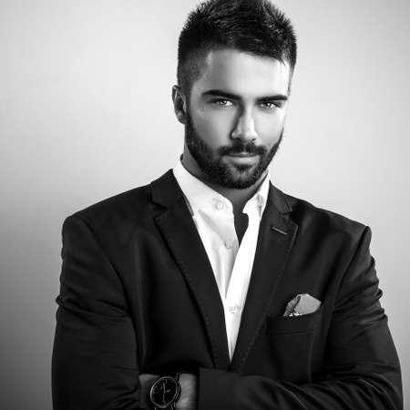 blackwhite: Elegant young handsome man. Black-white studio fashion portrait.