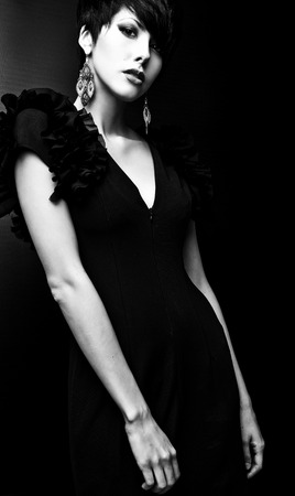 Black-white portrait of beautiful brunette woman. photo