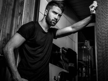 blackwhite: Handsome men indoor. Black-white portrait. Stock Photo