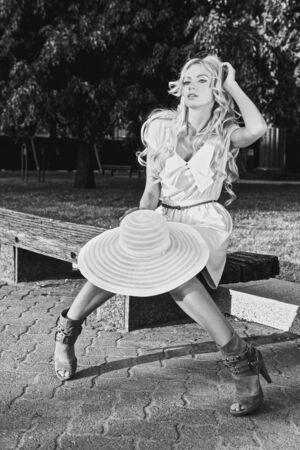 Black-white portrait of beautiful blonde woman outdoor. photo