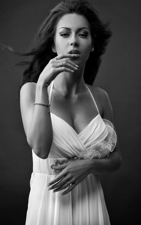 glamour nude: Black-white portrait of beautiful brunette woman in fashionable dress.