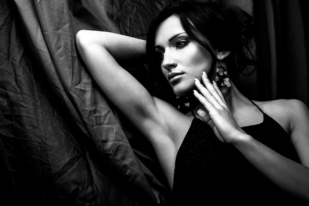Black-white portrait of beautiful brunette woman. photo