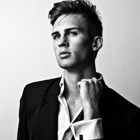 Elegant stylish handsome man. Black-white studio fashion portrait. Imagens