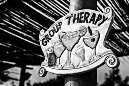 group therapy: Guide fun sign - group therapy. Black-white photo.