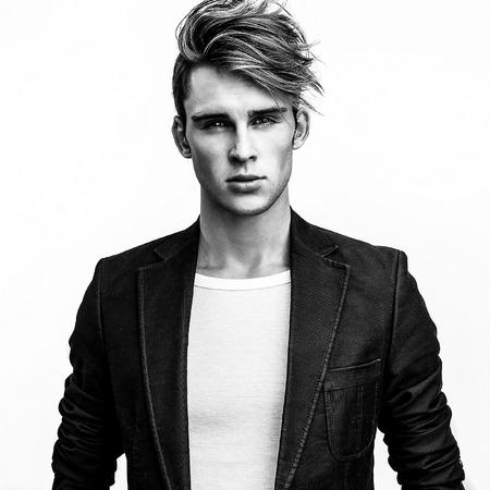 Elegant stylish handsome man. Black-white studio fashion portrait. photo