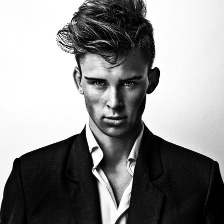 stylish men: Elegant stylish handsome man. Black-white studio fashion portrait.
