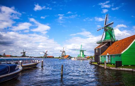 zaandam: ZAANDAM, NETHERLANDS - AUGUST 14, 2016: Dutch windmills in Zaandam with dramatic cloudy sky. Zaandam - Netherlands. Editorial
