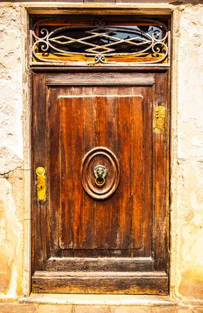 Ancient Venetian wooden door.