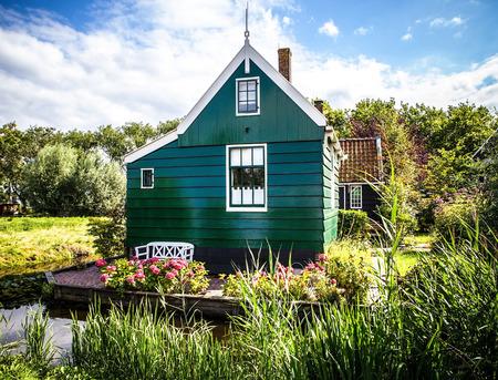 zaandam: ZAANDAM, NETHERLANDS - AUGUST 14, 2016: Traditional residential Dutch buildings close-up. General landscape view of city building and traditional Dutch architecture. Zaandam - Netherlands.