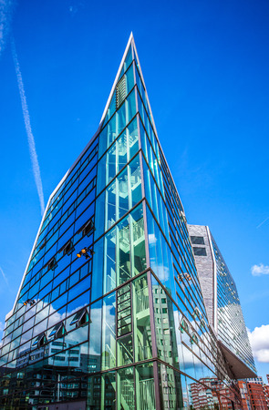 fasade: AMSTERDAM, NETHERLANDS - AUGUST 15, 2016: Palace Of Justice In Amsterdam Is A New Landmark Of Western IJ Docks. Amsterdam - Netherlands.