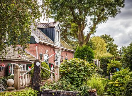 fasade: ZAANDAM, NETHERLANDS - AUGUST 14, 2016: Traditional residential Dutch buildings close-up. General landscape view of city building and traditional Dutch architecture. Zaandam - Netherlands.